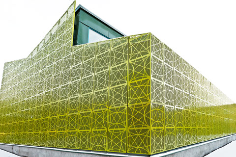 Lime Green Network Of Perforated Cladding Panels Stylepark