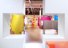 "A museum for children in ""Fiery Red"" and ""Festival Pink"
