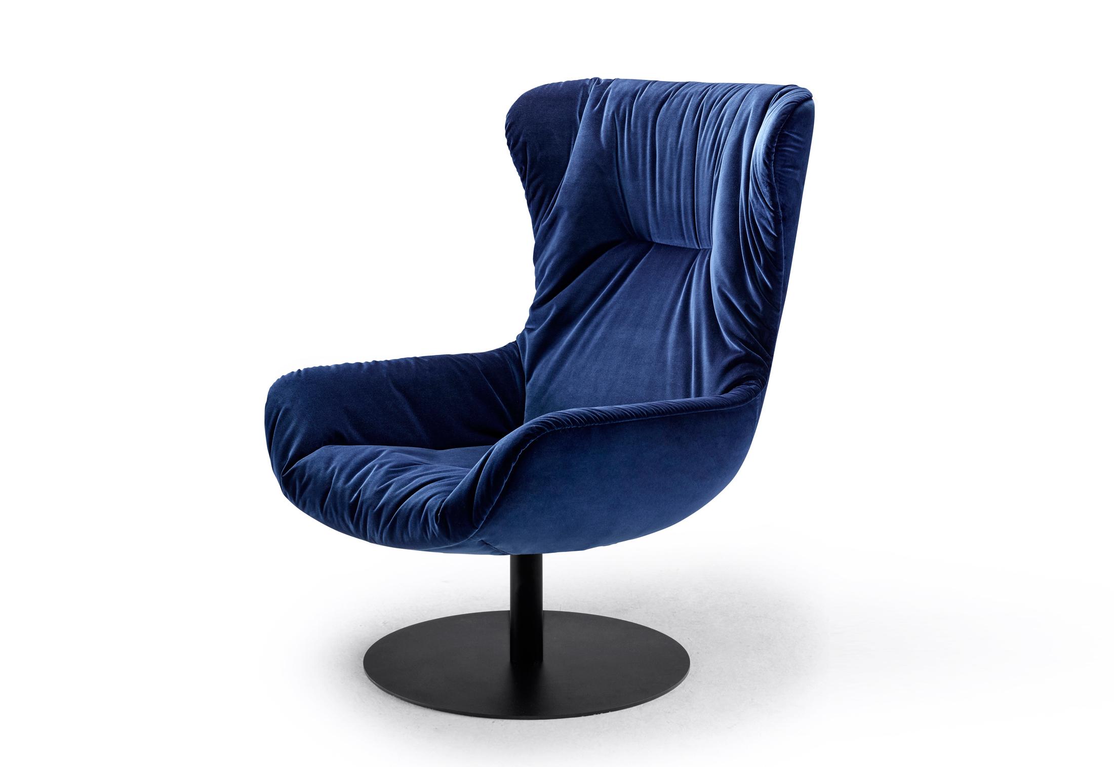 Leya wingback chair with central leg by Freifrau