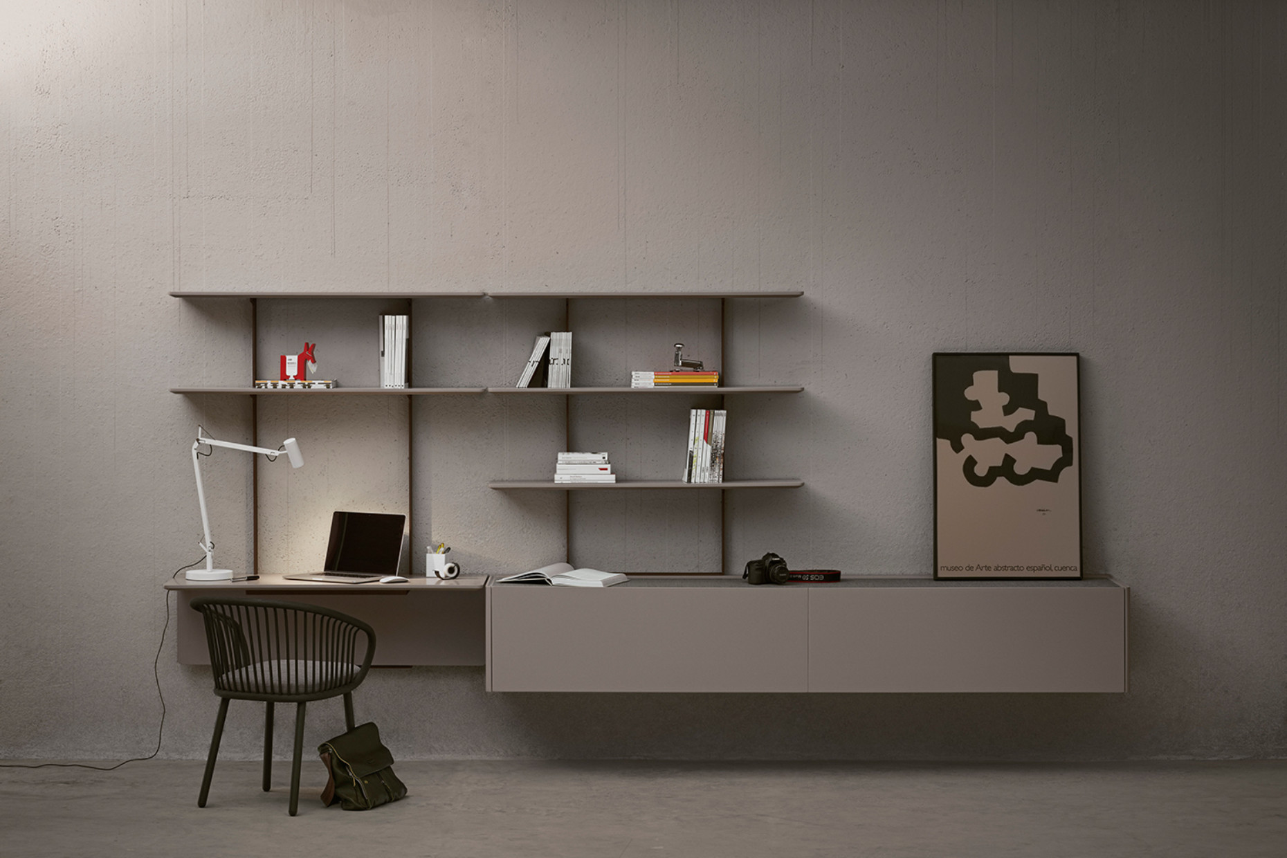 "In the ""Team"" desk and shelving unit designed by Mario Ruiz for Expormim, work and home life seamlessly meld: When the desk is not needed, it becomes part of the shelving unit."