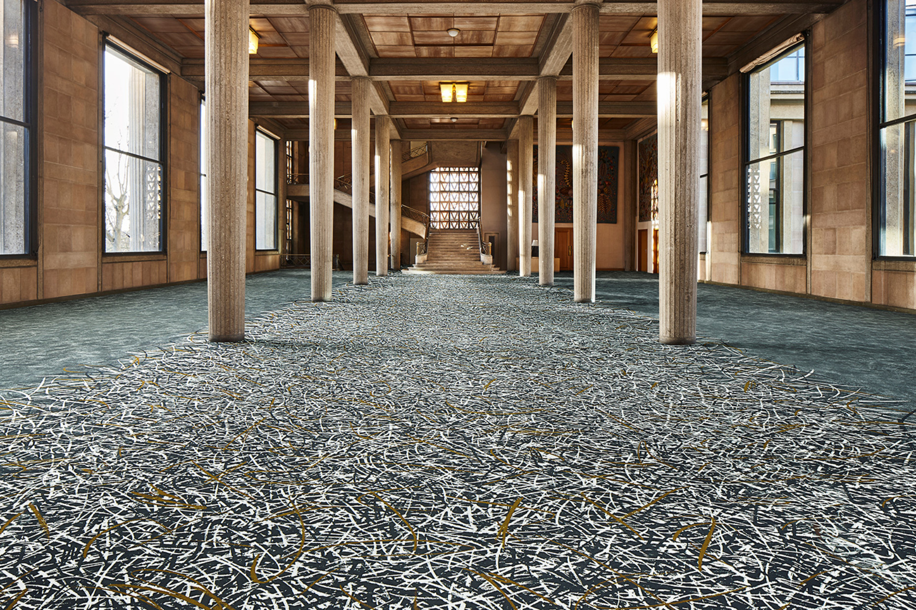 "Philippe Starck designed the ""Flotex by Starck"" textile floor covering for Forbo Flooring. The pattern was applied to the fibers by means of high-resolution digital-printing technology."