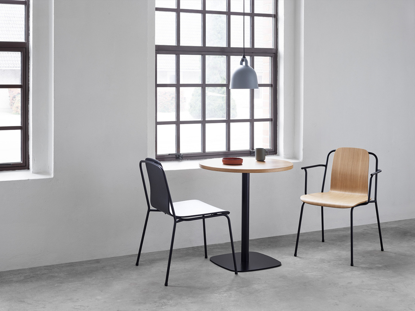"Simon Legald created ""Studio"" for Normann Copenhagen. The chair series has a strong graphic look and features a slender backrest that represents an original take on 1960s designs."