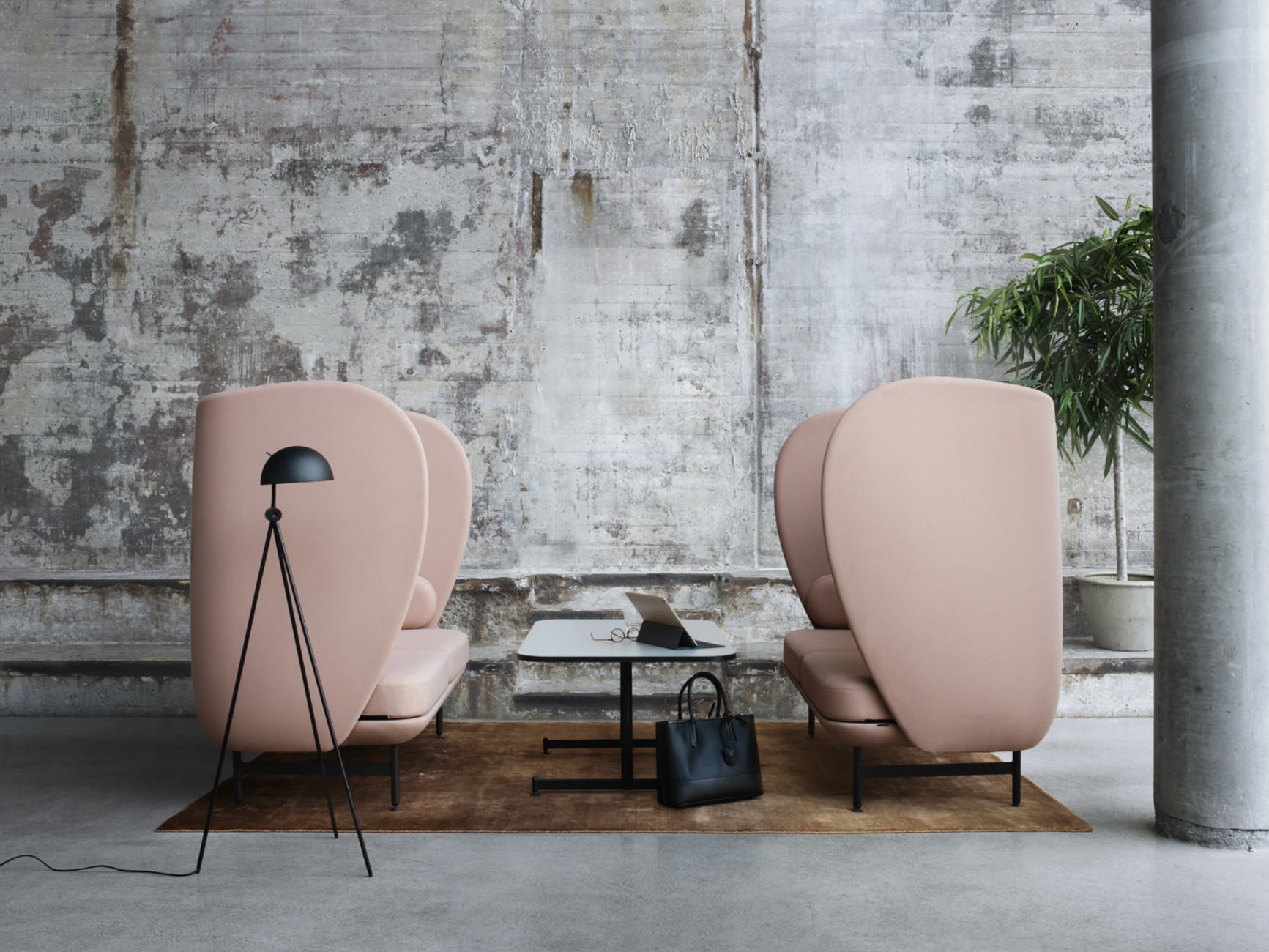 """Plenum"" for Fritz Hansen is Jaime Hayon's interpretation of the cocooning sofa: He has translated the task into huge wing chairs."