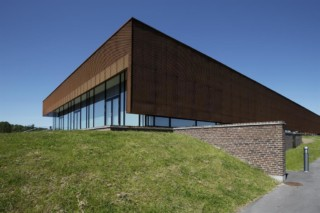 Perforated sun screens in Corten, Sports hall in Ringsted Campus  by  RMIG