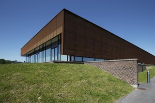 Perforated sun screens in Corten, Sports hall in Ringsted Campus  by  RMIG City Emotion
