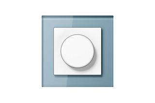 A Creation Glass Rotary Dimmer in blue grey  by  JUNG