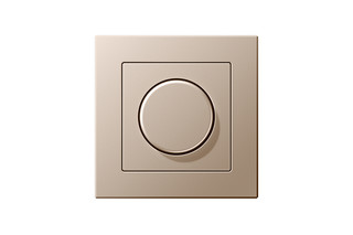 A Creation Rotary Dimmer in champagne  by  JUNG