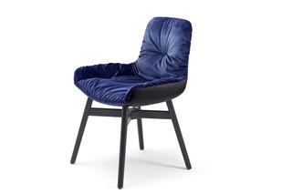 Leya armchair low with wooden frame cross  by  Freifrau