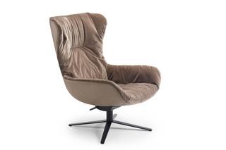 Leya wingback chair with rocker-/tilt mechanism and x-base frame  by  Freifrau