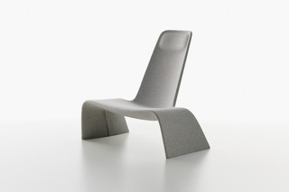 Land lounge chair upholstered  by  Plank