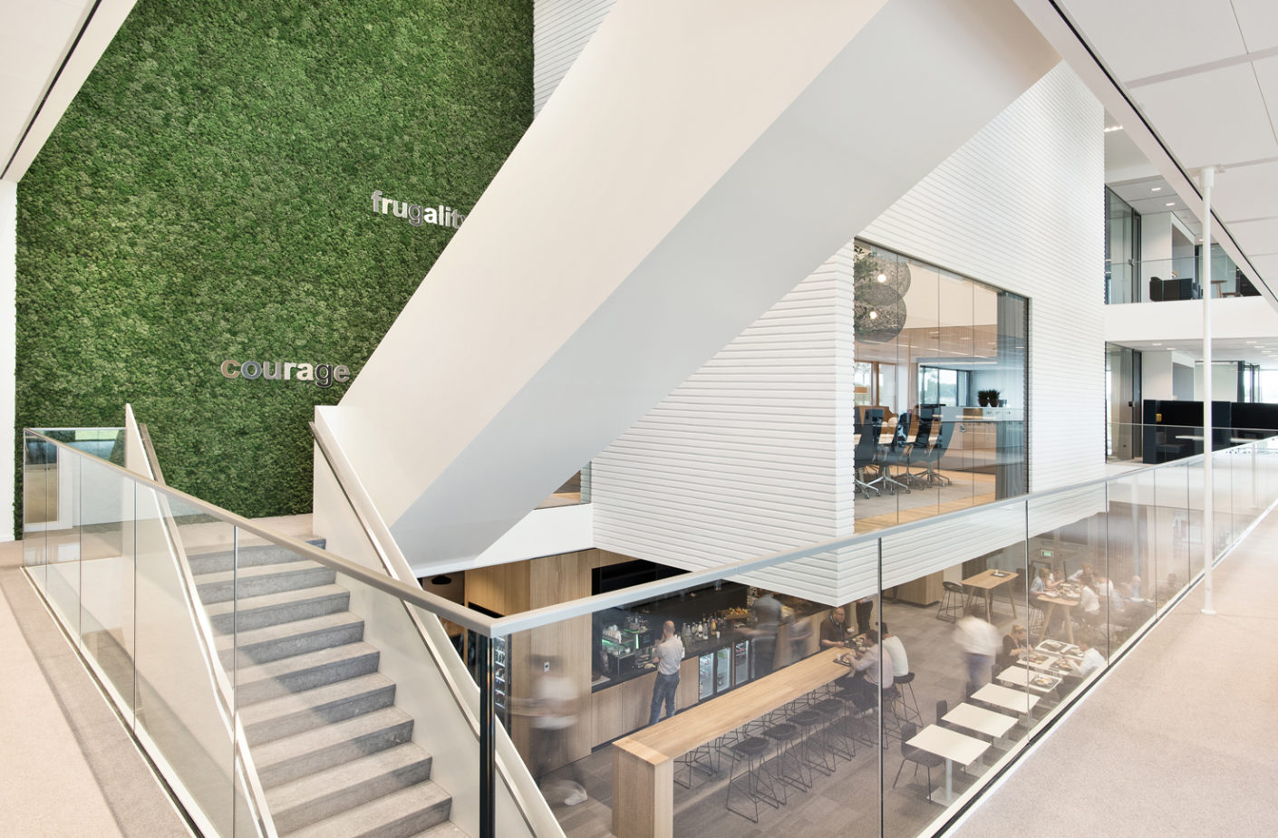 """Dreessen Willemse Architecten have designed the central """"Össur World,"""" which serves with """"Aava"""" chairs by Arper as a meeting point and a restaurant."""
