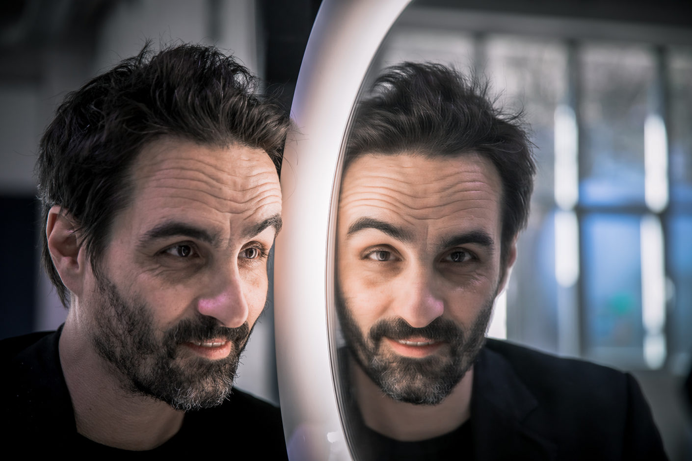 """Designer portrait: Gabriele Chiave with a mirror from the new Laufen collection """"The New Classic"""""""