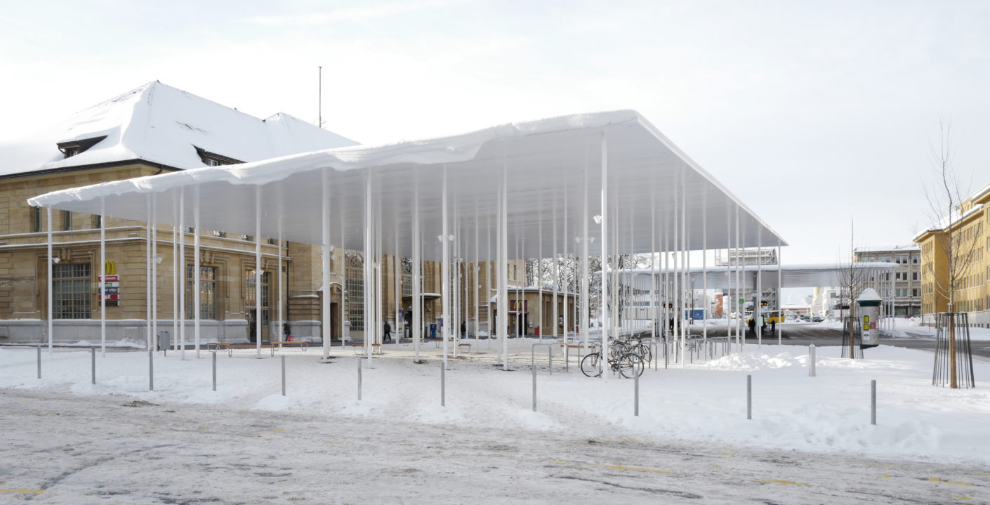 You can't see the roofs for the pillars. 150 thin white pillars support the new roofs in front of the station in La Chaux-de-Fonds.
