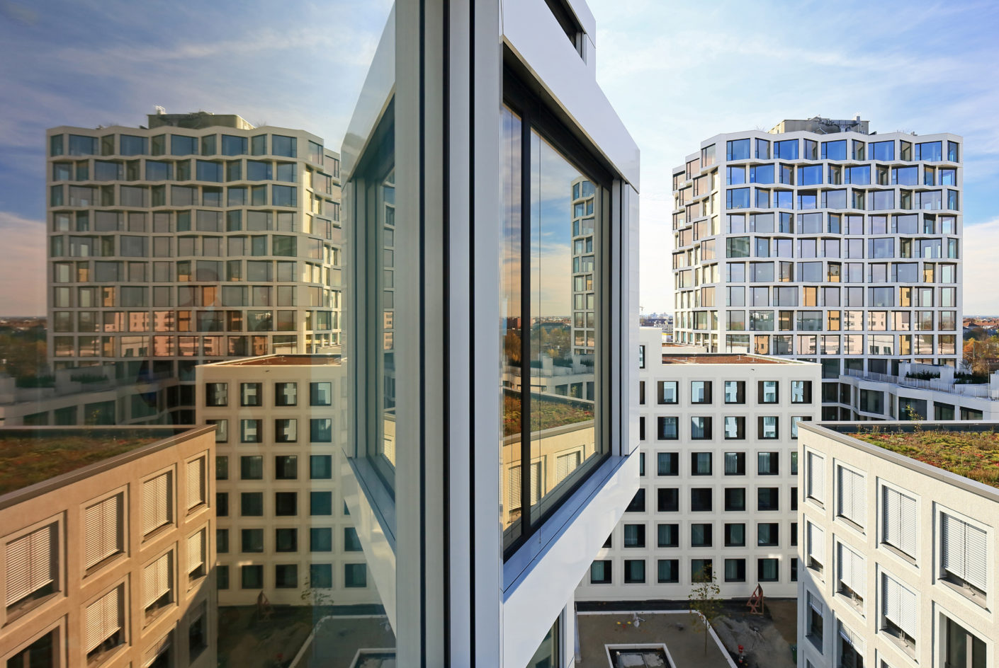 The residential buildings offer interesting views from every perspective with a striking cubature and bodied depth panorama windows.