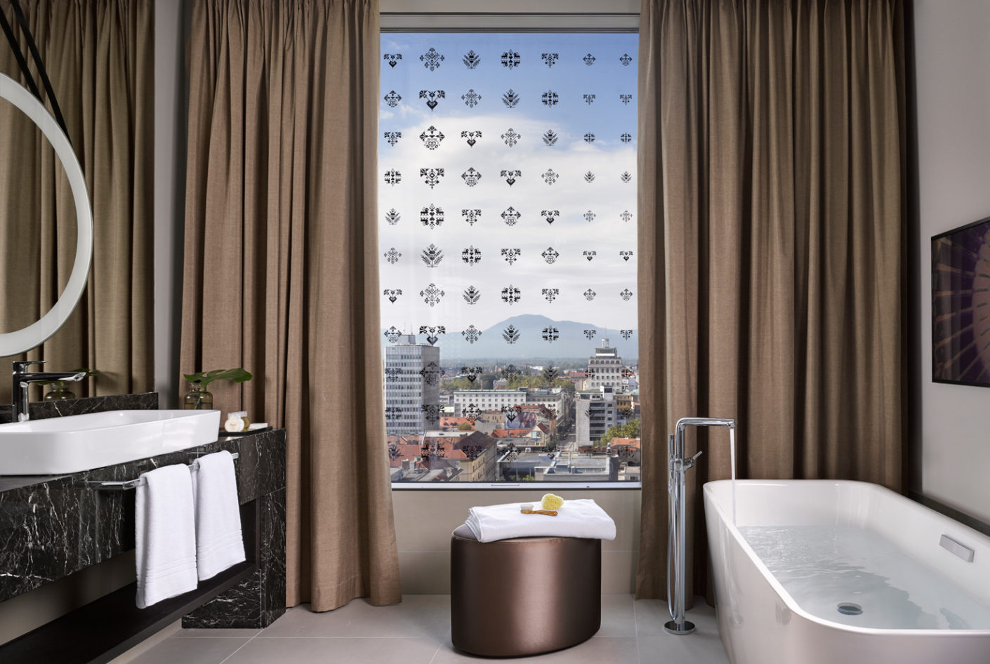 "The guest bathrooms with daylight include free-standing bath from the ""BetteArt"" series."