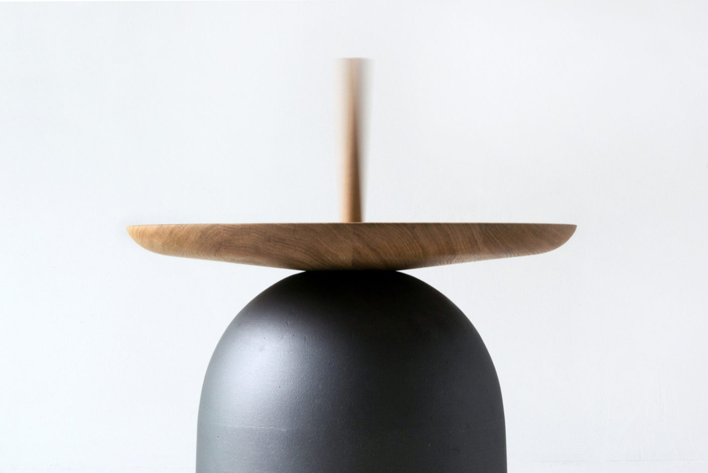 "The side table ""Campane"" brings with the function of a bell rhythm in the room."