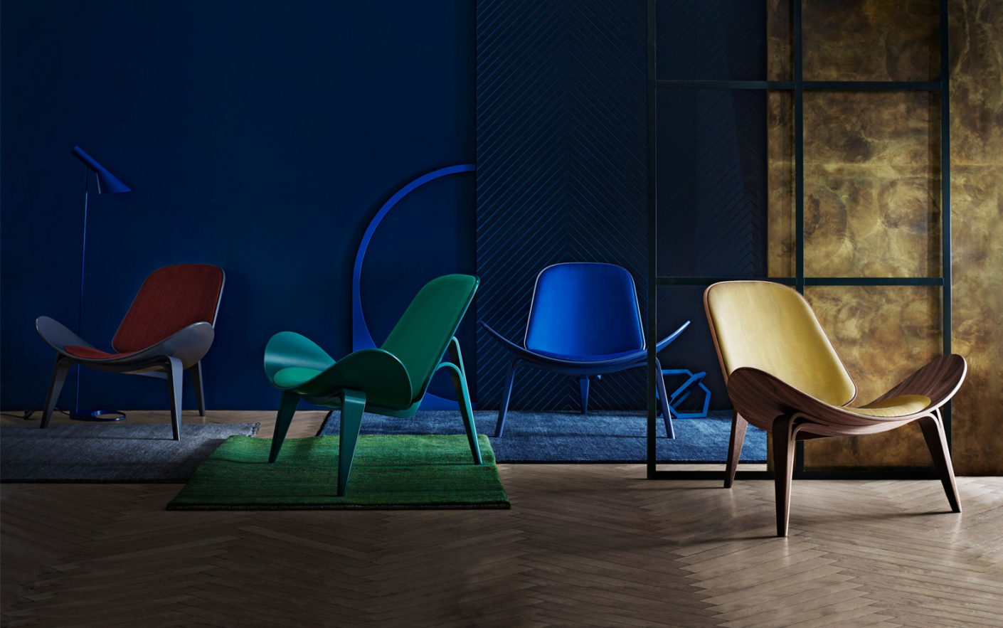 Carl Hansen & Søn used the intense colors of gemstones as inspiration for the covers of the Shell Chair CH 07.