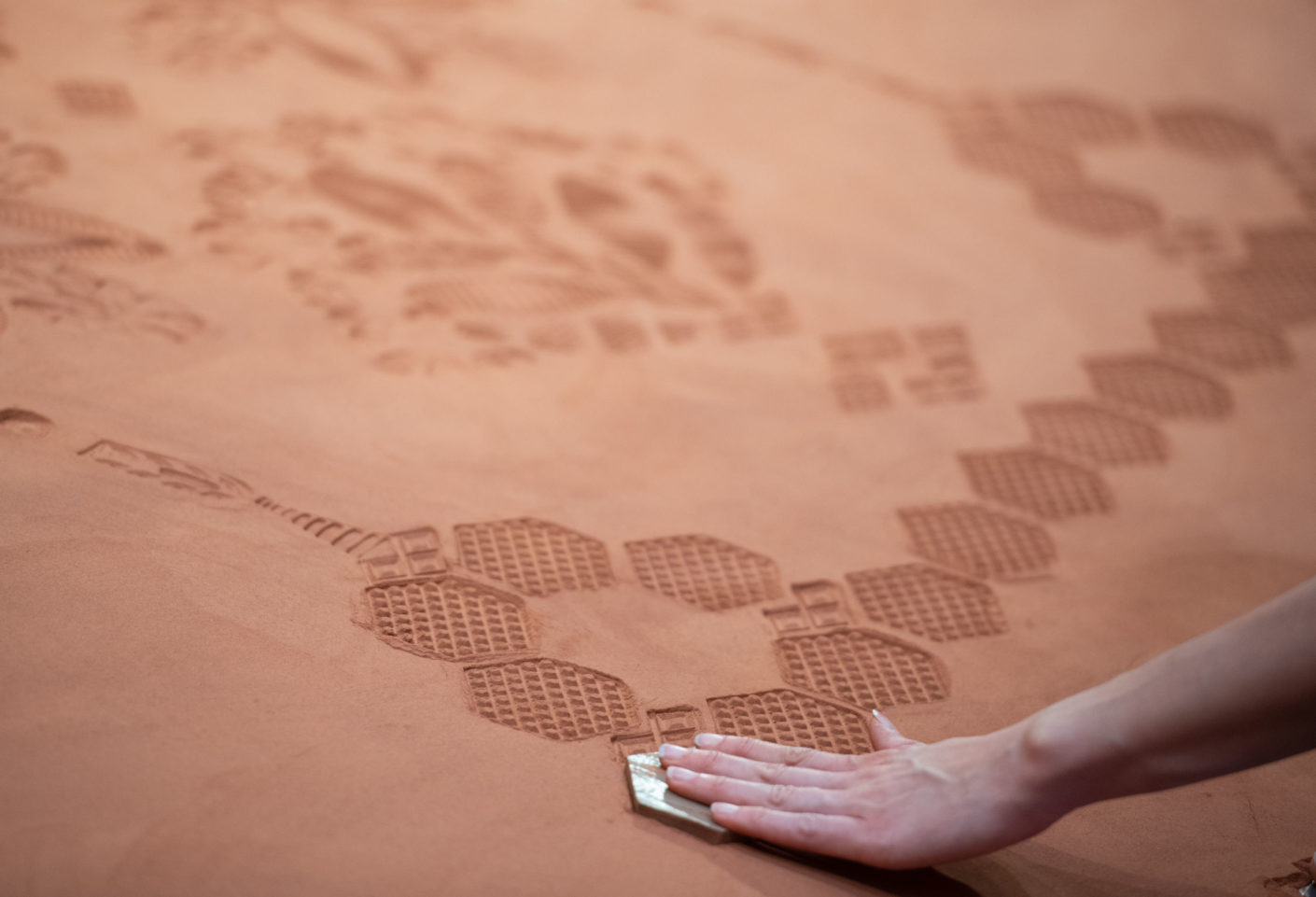 Artist Rena Detrixhe brought red Oklahoman sand with her to highlight the impact of humans on nature.