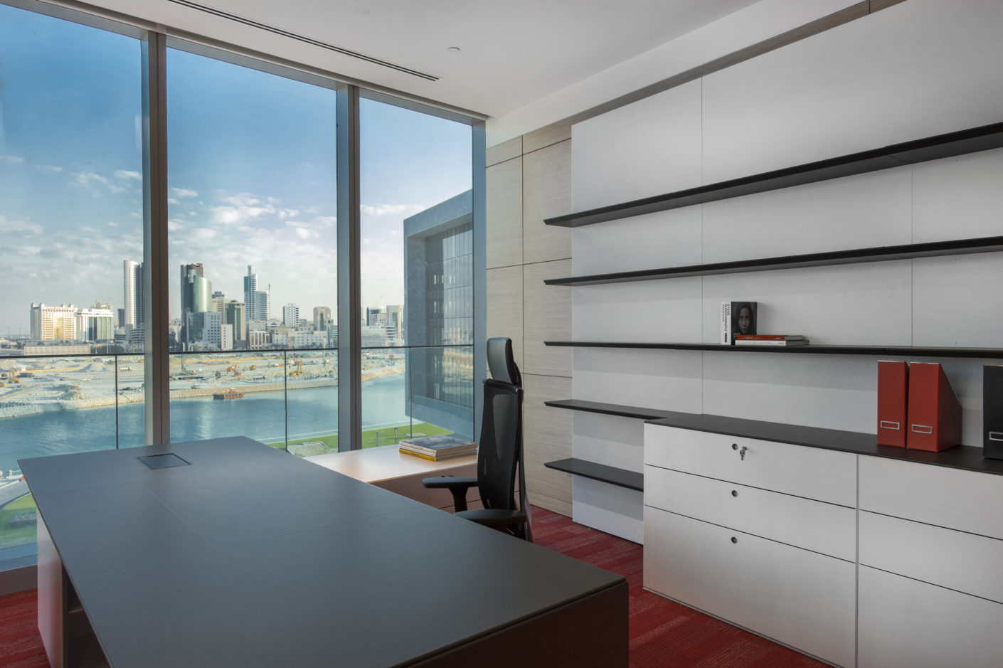An individual office in the new headquarters of the Al Baraka banking group in Bahrain with a view of the skyline.