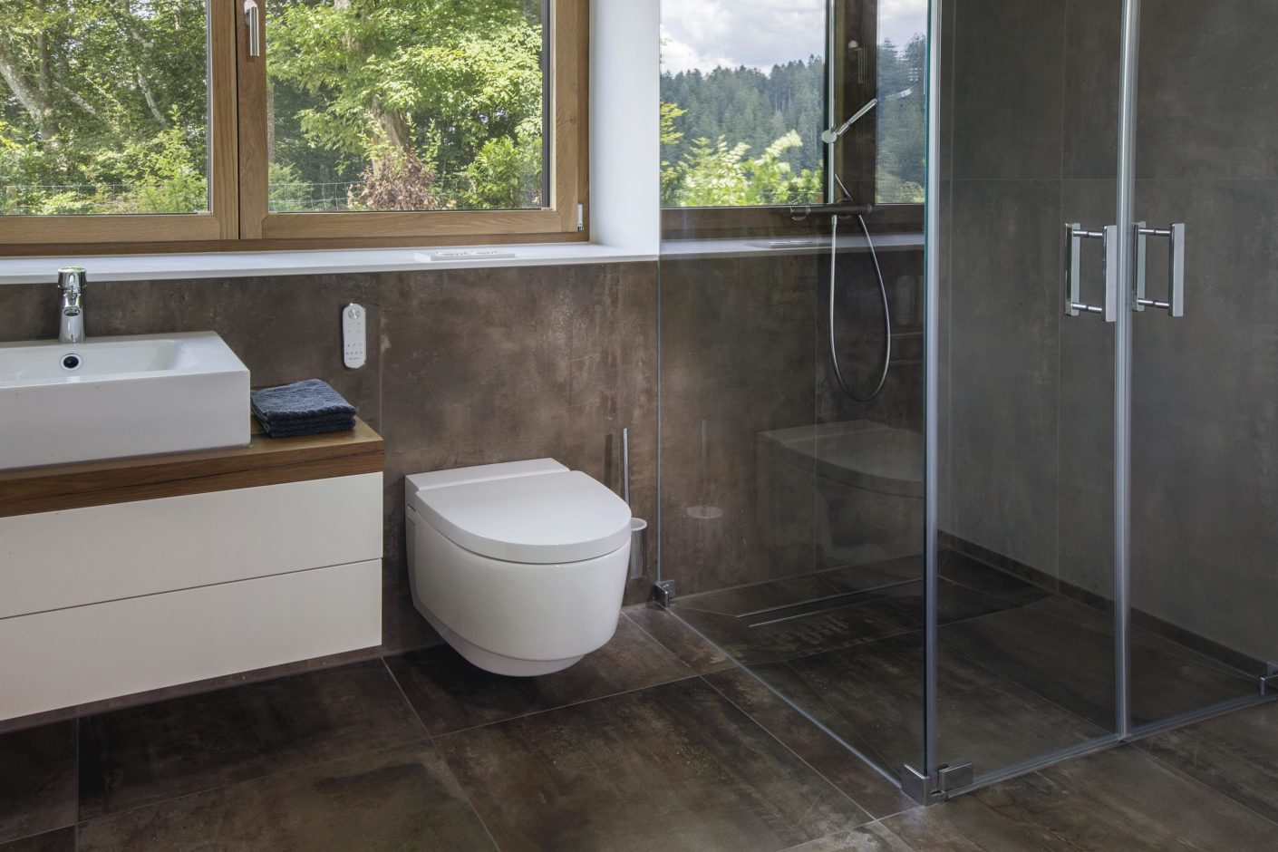 "The ""Geberit AquaClean Mera Comfort"" shower toilet eliminates the need for an additional bidet in the bathrooms."