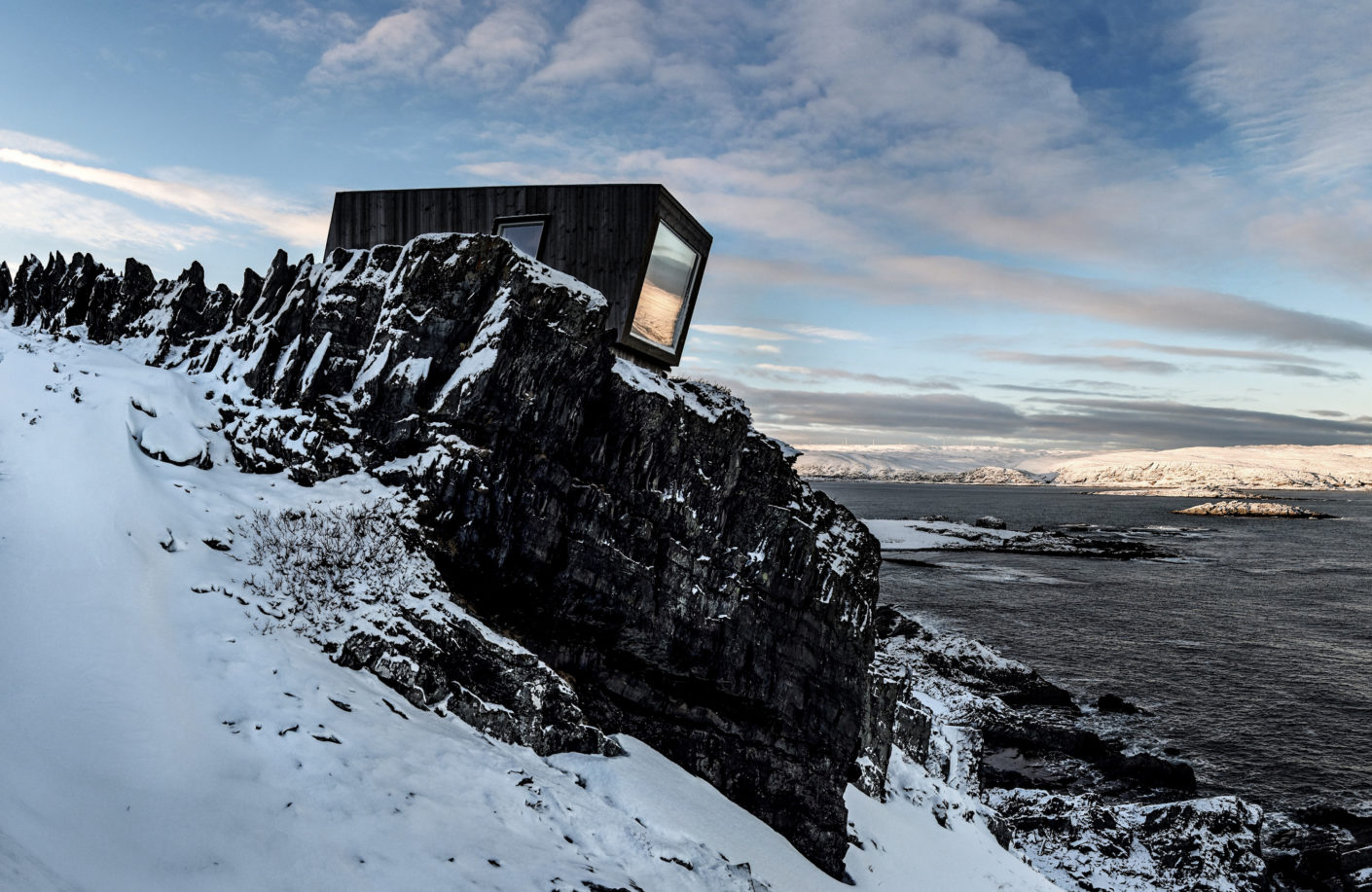 Superb view: The shelter is perched above the Kongsfjord like a piece of black wood.