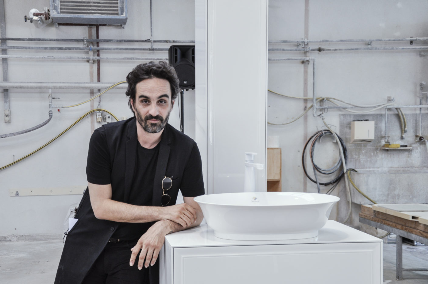 "Gabriele Chiave, Creative Director of Studio Marcel Wanders, with a washbasin from the new collection ""New Classic""."