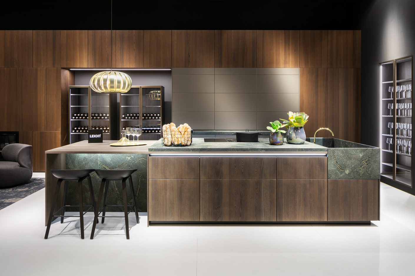 """At the centre of Leicht's booth was an impressive kitchen island combining dark wood, marble, brass and """"Umbra"""" surfaces from the """"Les Couleurs Le Corbusier"""" collection."""