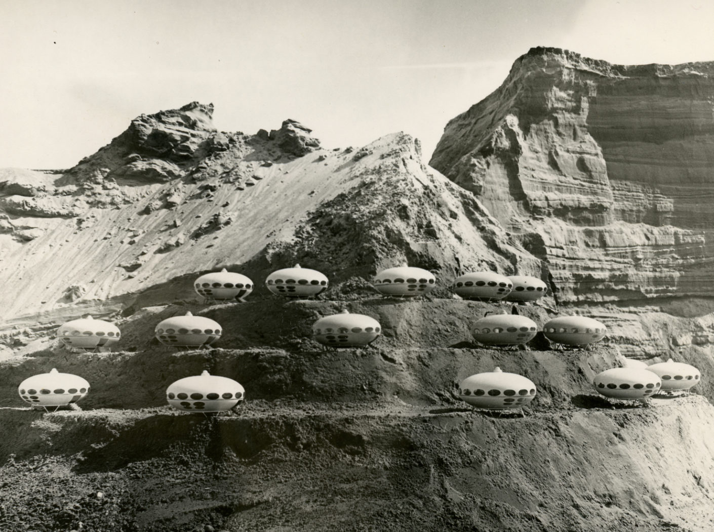 """Futuro"" houses on a hillside, late 1960s. The photo was taken with scale models of the ""Futuro""."