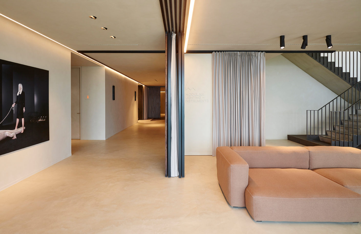 Wooden room dividers and floor-length drapes are used to create spaces in which employees can enjoy their privacy.