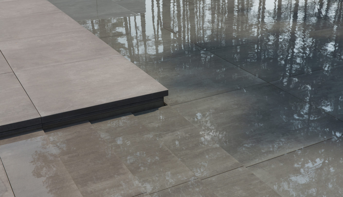 One section of the patio floor can be lowered smoothly to transform into a swimming pool complete with elegant gentle steps.