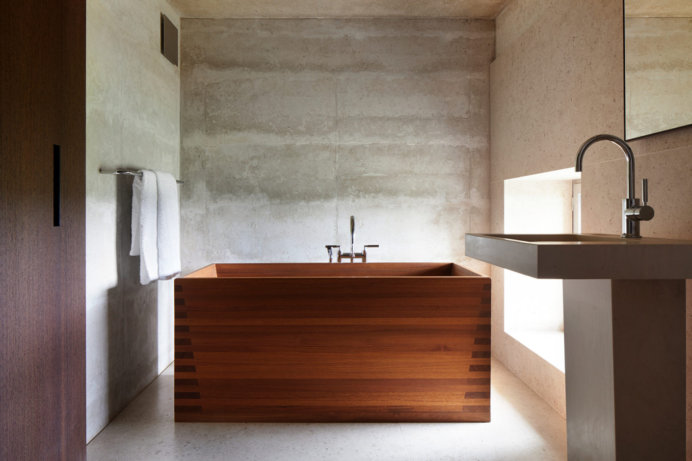 A bathroom with a Furo wooden tub.