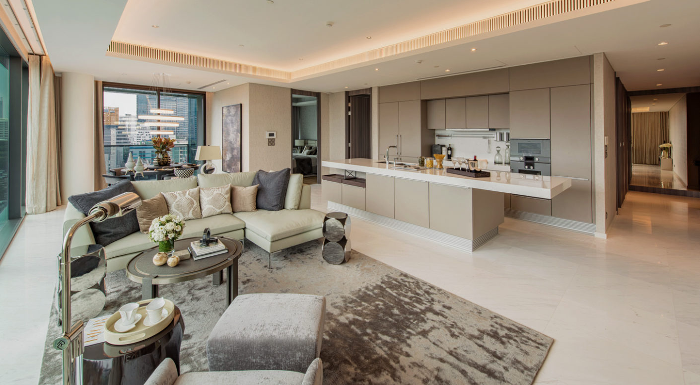 The spacious living rooms in the new Sindhorn Tonson luxury complex leave plenty of room for hospitality with an open cooking area.