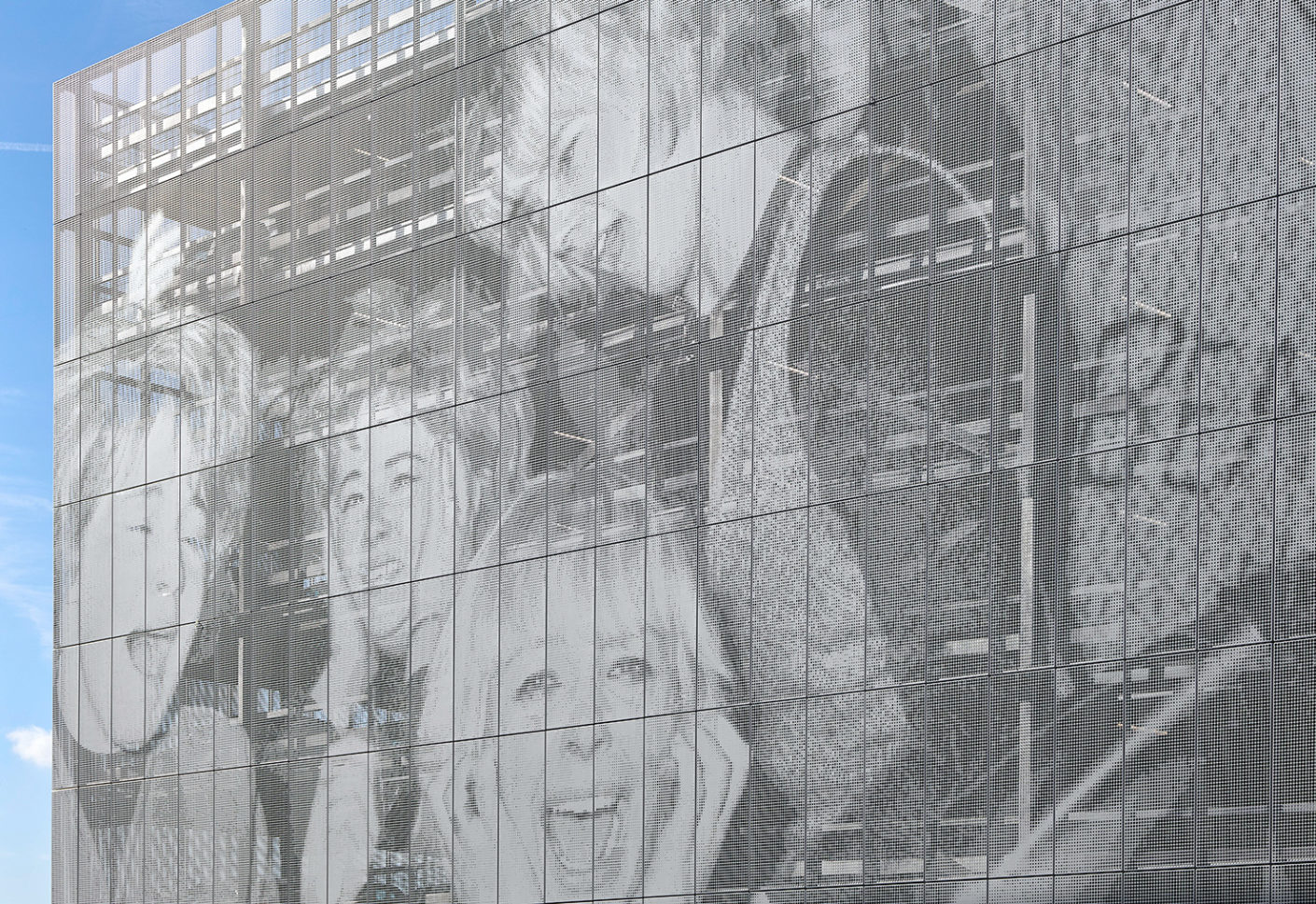 By perforating the sheets, Studio Egret West has reproduced a black and white photograph of screaming Beatles fans.