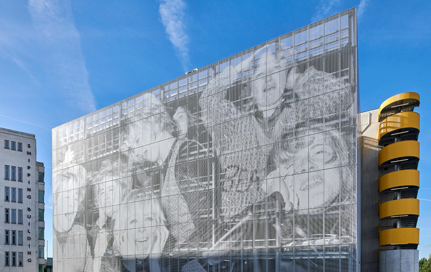 The façade of the multi-story carpark has been clad in 3,500 square meters of perforated metal courtesy of RMIG.