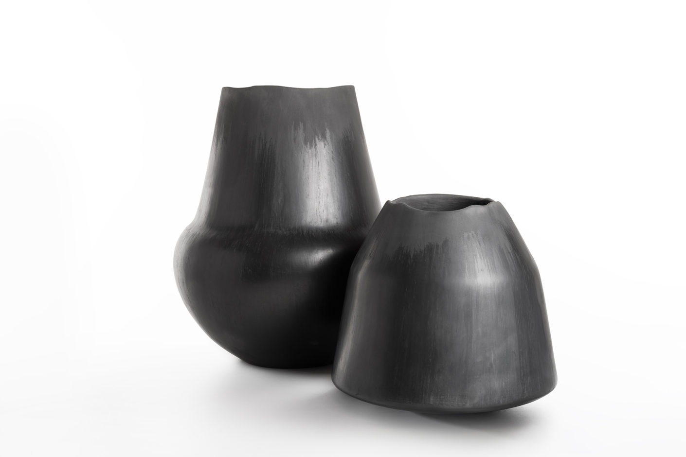 "Two ""Buccheri"" vases by Roberto Sironi, carved from wood and then charred in a controlled process."