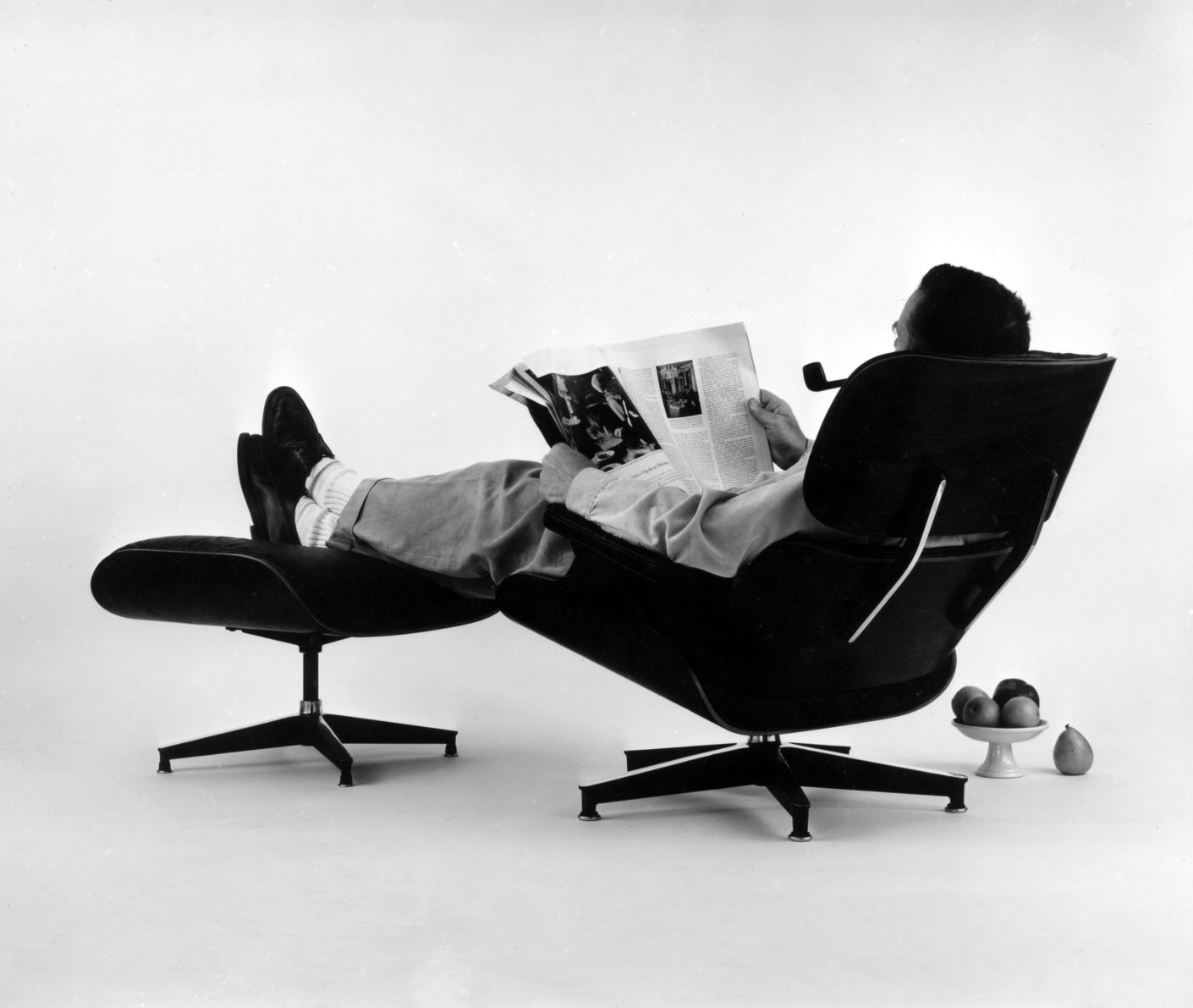 Vitra Design Museum An Eames Celebration  Charles Eames In The Plywood Lounge And Ottoman 1956
