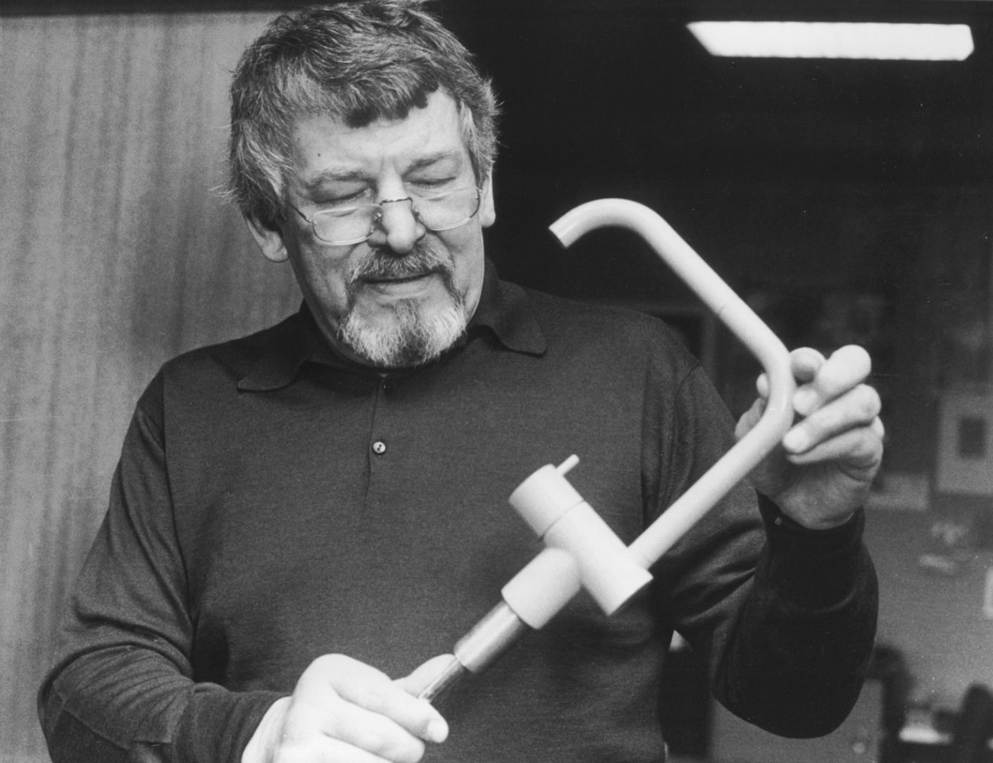 """A good feel for design: company founder Verner Overgaard with a prototype of the """"KV1"""" faucet by Arne Jacobsen."""