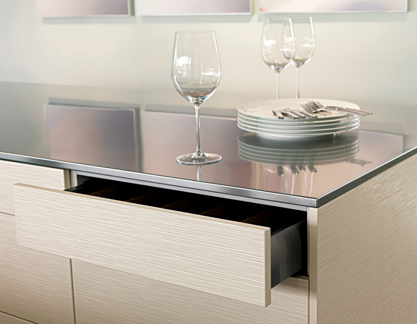 The drawers and cabinets are opened with gentle pressure - handles are not necessary.