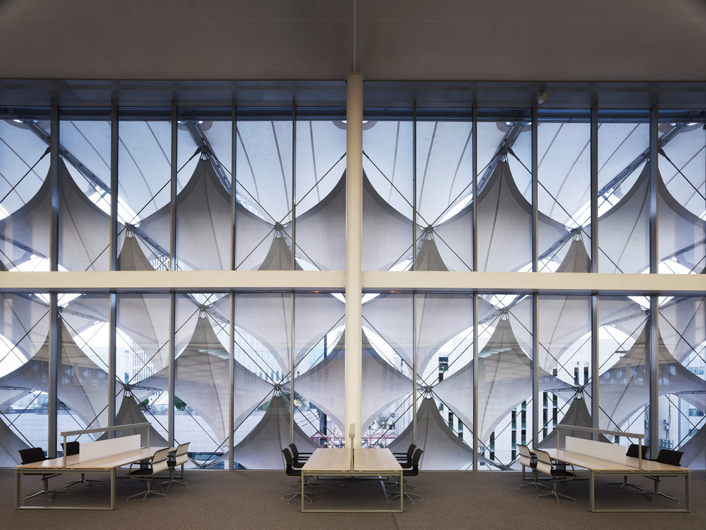 The awnings in front of the glass façade are reminiscent of Arabic tent constructions.