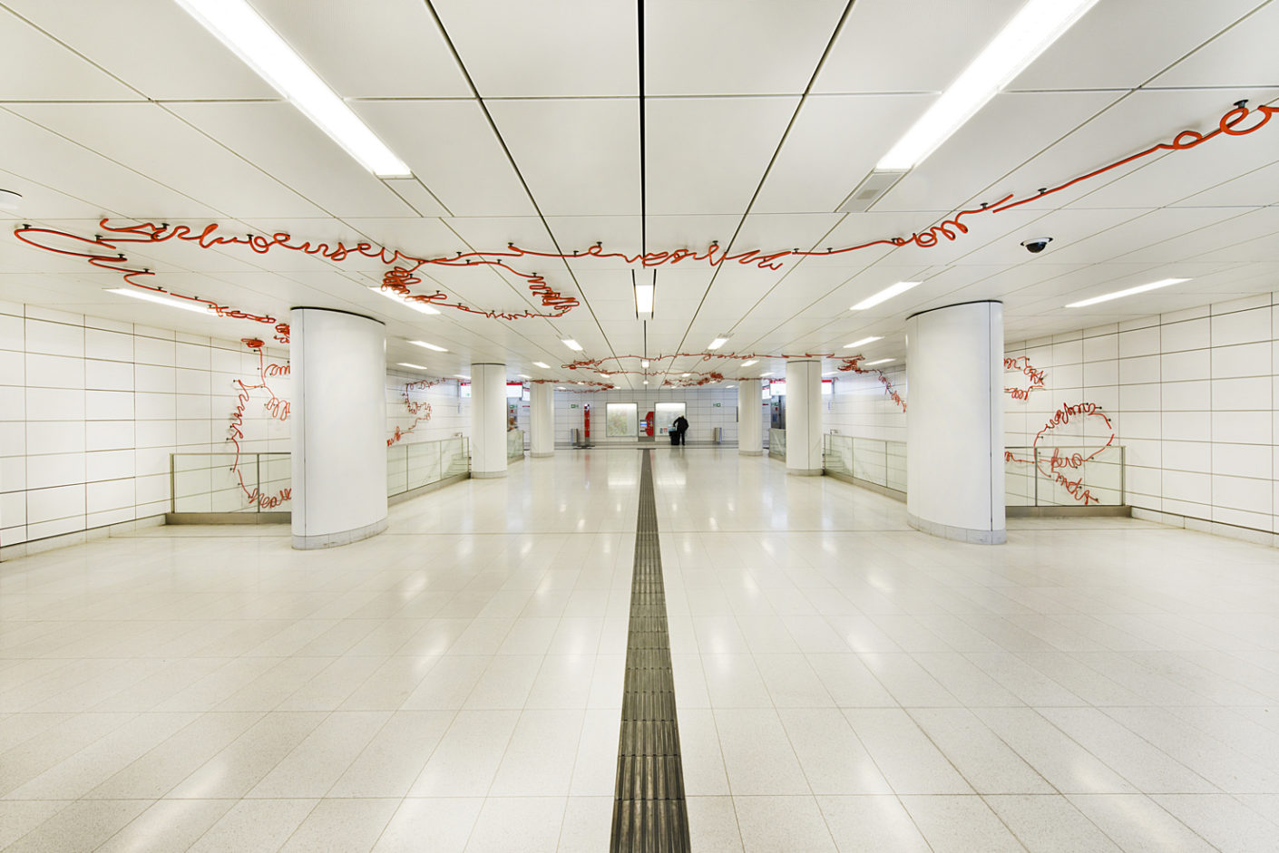 "An orange line connects itself across the station to letters: ""Spur X"" by Enne Haehnle makes the reference to the surface playfully."