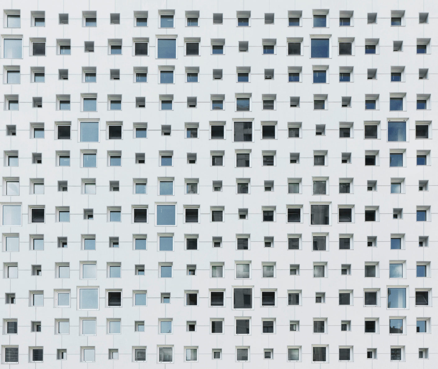 The architects of the new building were inspired by old lace embroidery and patterned wallpaper to create an elegant perforated pattern as a facade.