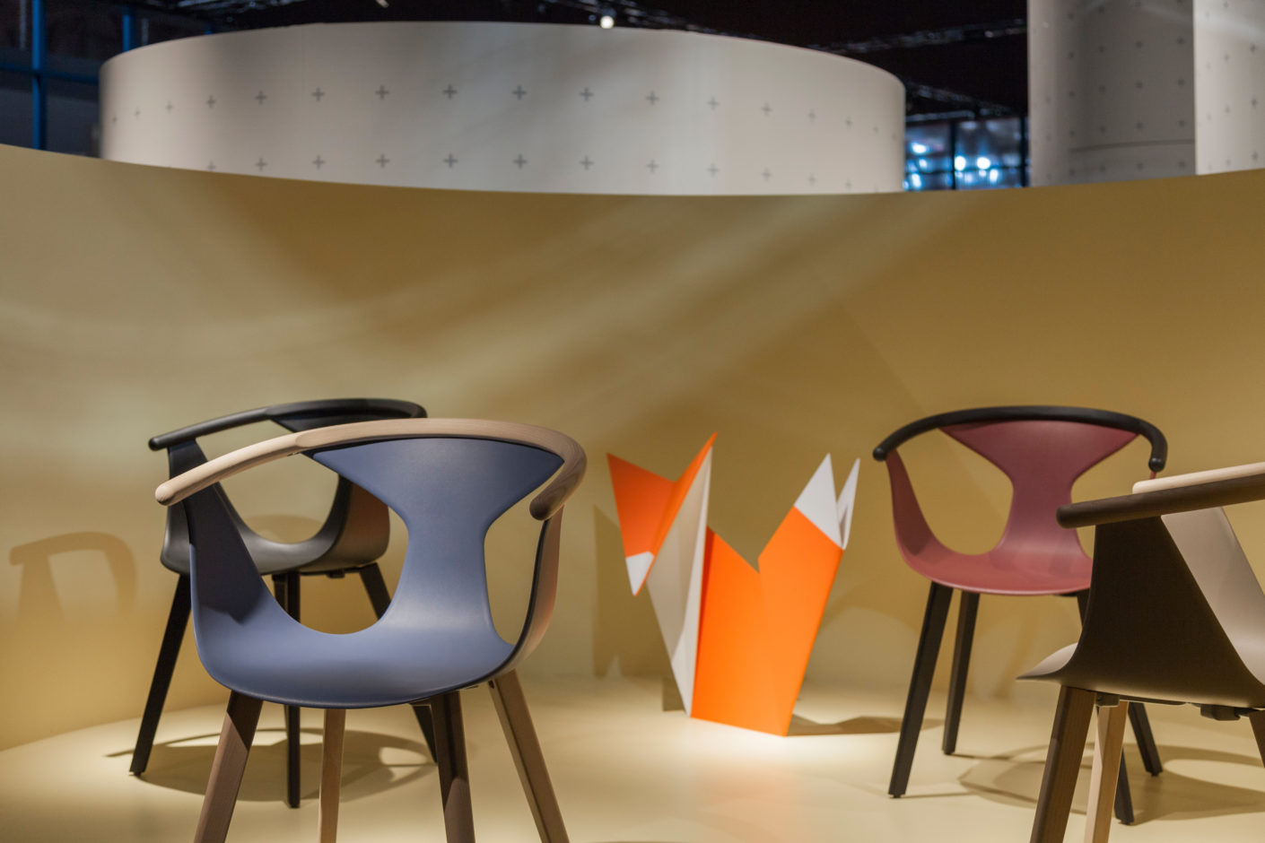 """Fox"" by Pedrali is stackable and surprised with an elegant shape and a material mix of plastic and ash wood."