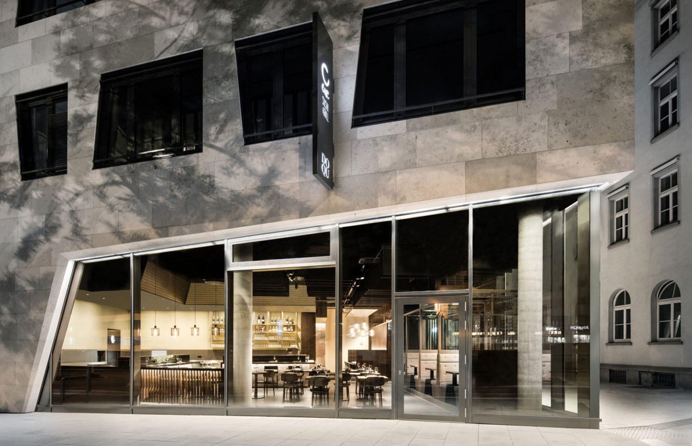 """DIA – Dittel Architekten combined for the japan Restaurant """"Enso Sushi and Grill"""" in Stuttgart dark wood with earth tones, brass and warm light."""