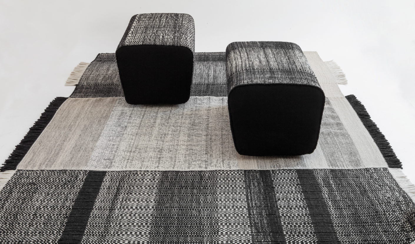 """The """"Tres"""" collection also features a pouf that is covered with the selfsame fabric as that used for the carpets."""