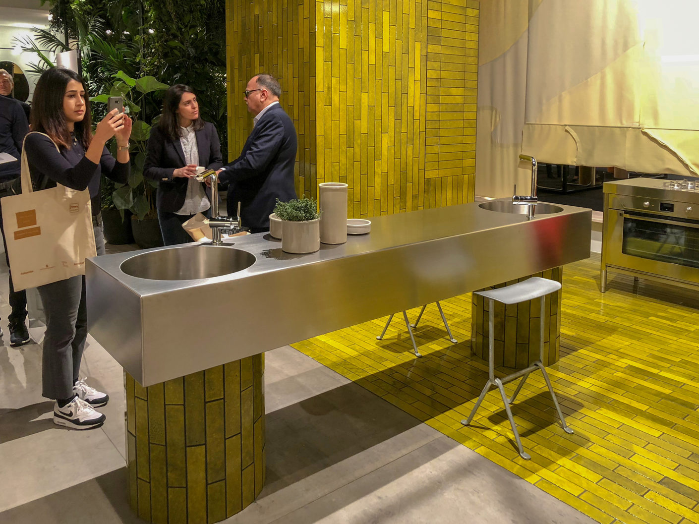 "In their ""house"" at the imm cologne, Kate and Joel Booy designed the kitchen with elements from Alpes Knox and an armature from Grohe as the centre of a large all-encompassing space."
