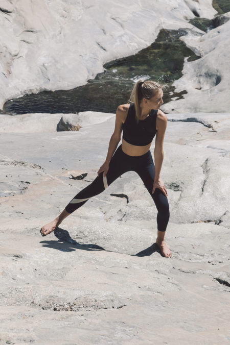 Yoga Pants with integrated vibration mechanism by Nadi X