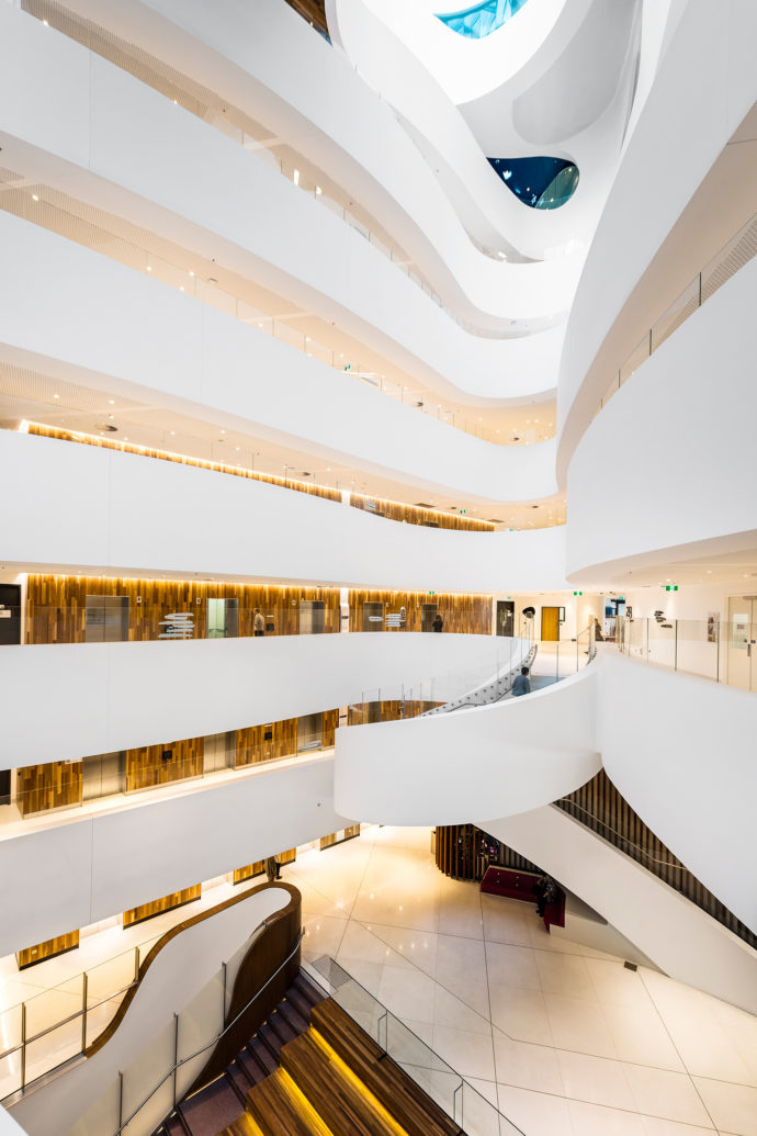 White ramp: the curving structure, spanning 130,000 square meter building is somewhat reminiscent of Frank Lloyd Wright's Guggenheim Museum.