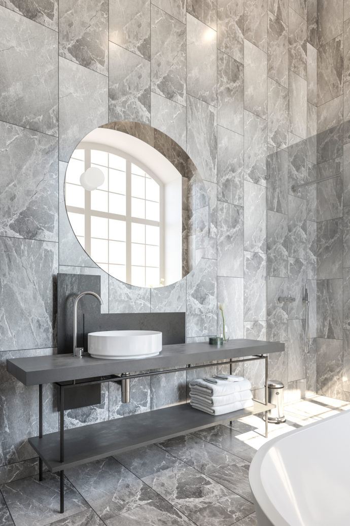 In the bathrooms, minimalist furniture complement the marble slabs.