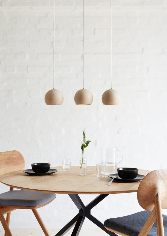 "The ball luminaire ""Lune Pendel"" by designer Sverre Uhnger is made of oiled and soap oak wood."