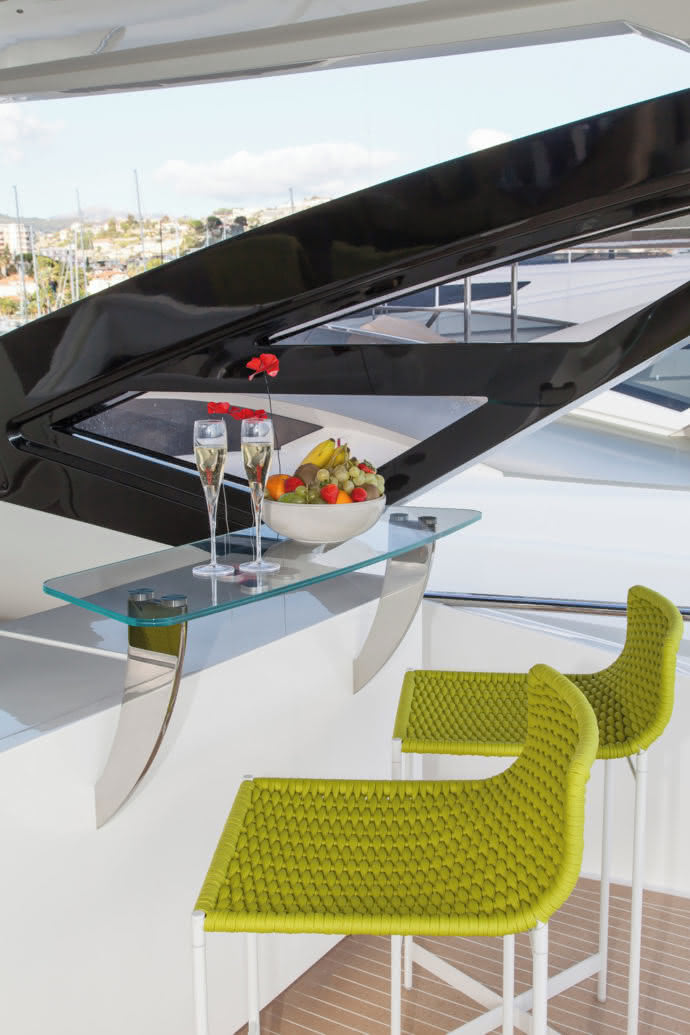 "With ""Heron"" stools in pale lime green, Paola Lenti sets the stage of the yacht in scene."